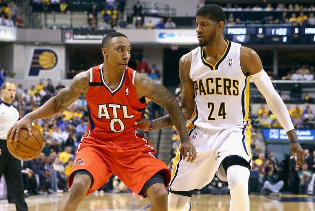 Jeff Teague y Paul George./ Getty Images