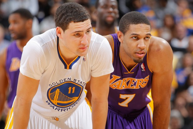 Klay Thompson y Xavier Henry./ Getty Images