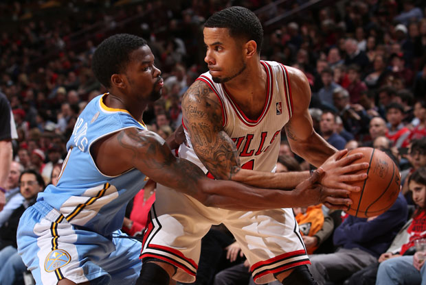 Aaron Brooks y DJ Augustin / Getty Images