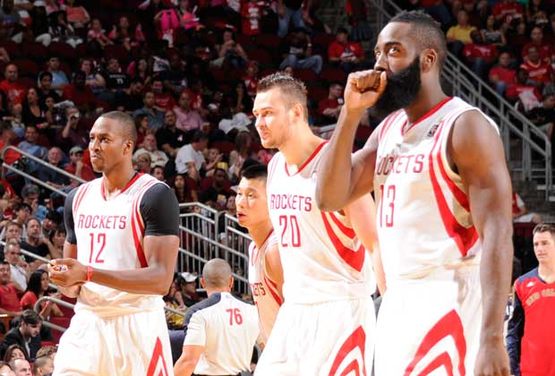 Dwight Howard, Donatas Motiejunas, James Harden / Getty Images