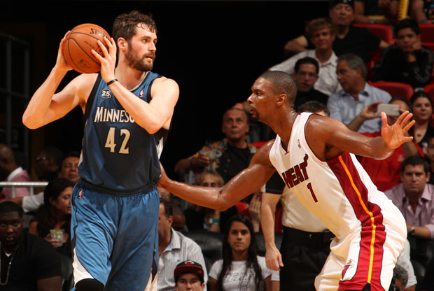 Kevin Love y Chris Bosh / Getty Images