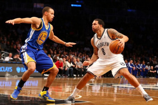 Stephen Curry y Deron Williams./ Getty Images