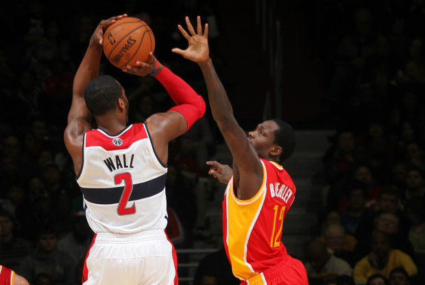 John Wall y Patrick Beverley./ Getty Images