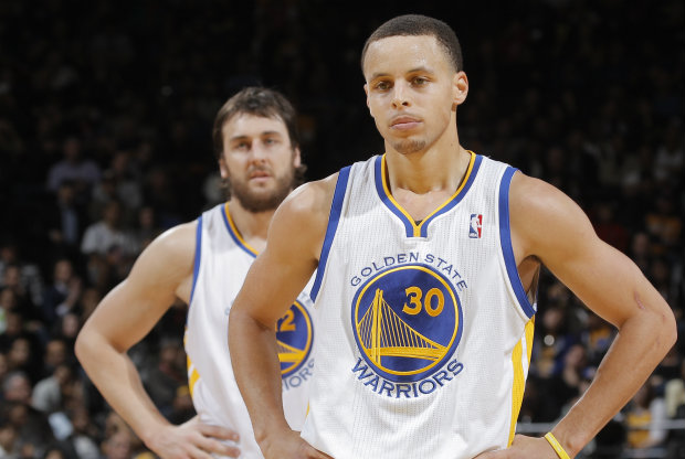 Stephen Curry y Andrew Bogut./ Getty Images