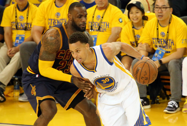 Stephen Curry vs. LeBron James / Getty Images