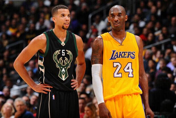 Kobe Bryant y Michael Carter-Williams durante un partido