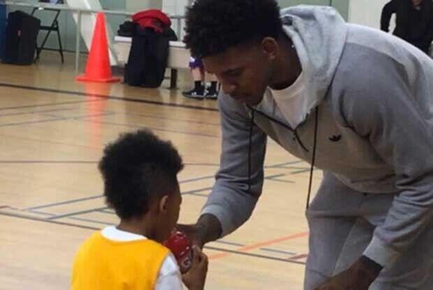 Nick Young, con su hijo