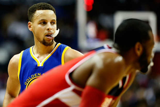 Stephen Curry y John Wall cara a cara