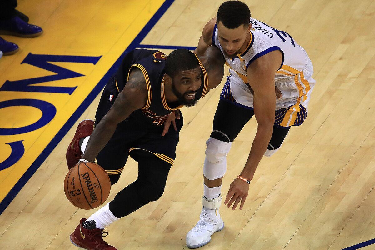 Stephen Curry jugador de los Warriors, y Kyrie Irving jugador de los Cavs