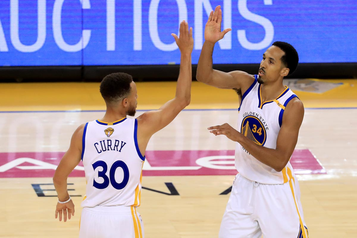 Stephen Curry y Shaun Livingston jugadores de Golden State Warriors